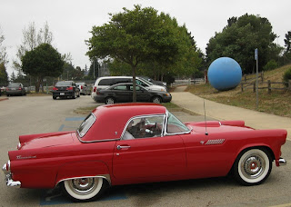 Vintage 1955 red Thunderbird convertible with hard top