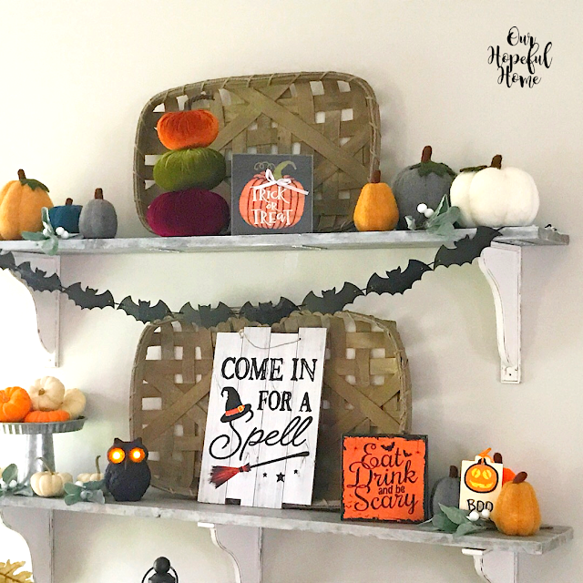 floating farmhouse shelves Halloween decor pumpkins signs owls bats