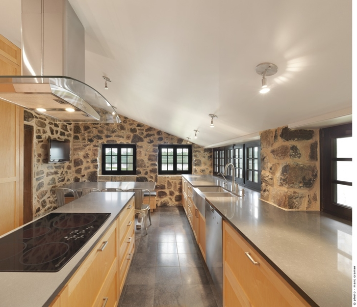 Old kitchen in Renovated Bord-du-Lac House by Henri Cleinge