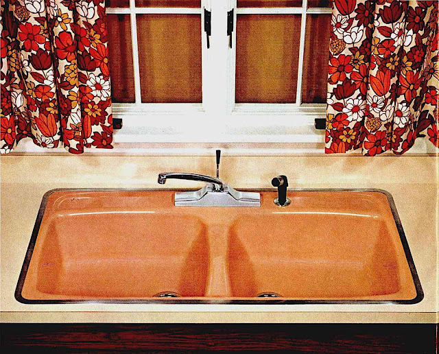 a 1960s modern sink in orange
