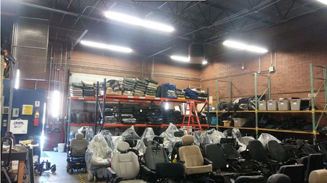 Photo of many wheelchairs in CReATE warehouse