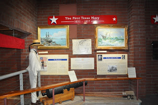 historic Texas Navy uniform, cannon, and artifacts