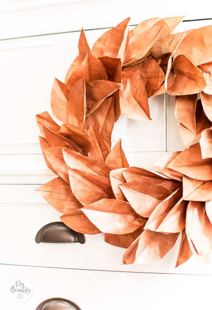 copper leaves wreath hung on dresser front