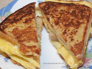 Reteta omleta impaturita retete culinare sandwich rapid din omletă de oua cu kaizer prajit si cascaval si felii de paine toast in ea pentru mancare mic dejun sau gustare,