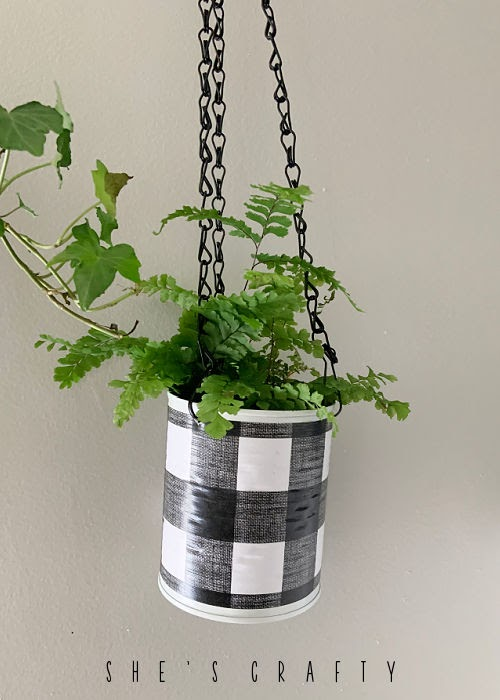 Plant holder made from mod podged can.