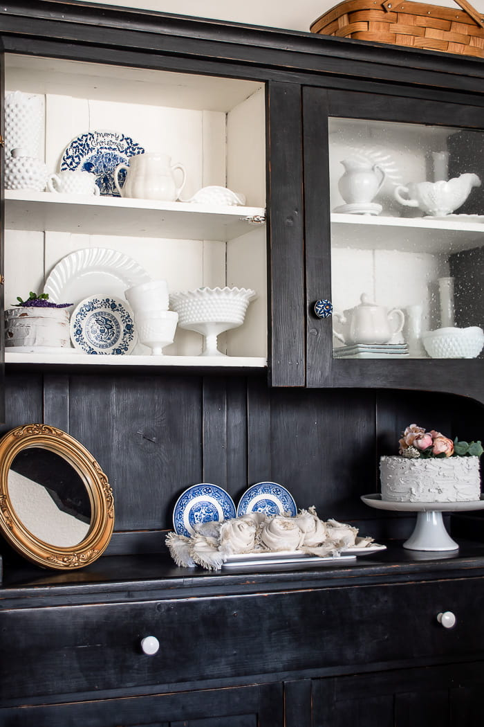 black hutch with white dishes