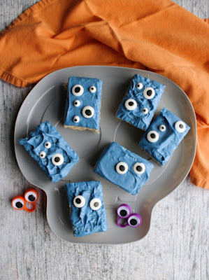 plate of blue monster rice krispie treats with eyeball rings