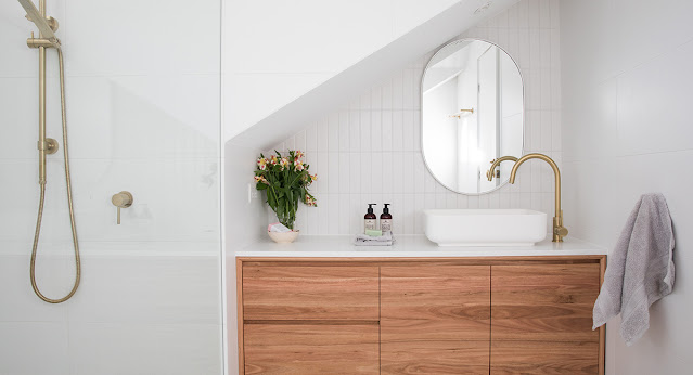 Shower with hand shower attachment in modern bathroom