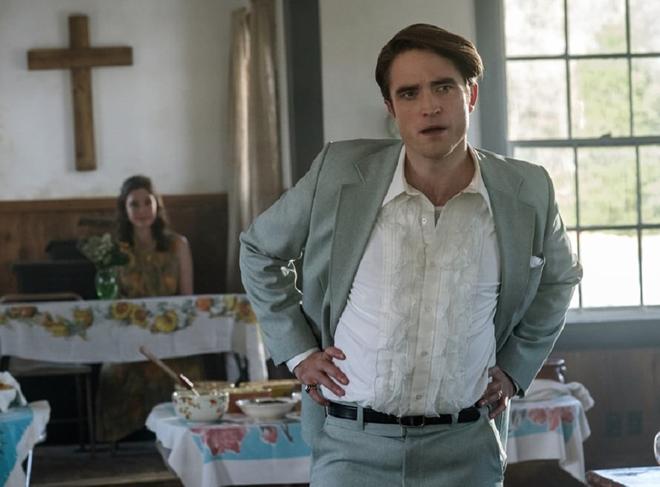 Robert Pattinson haciendo de reverendo