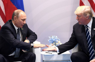 Trump, Putin in 'robust' first meeting at protest-marred G20 summit