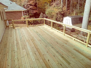 Outdoor deck with aluminum baluster railing