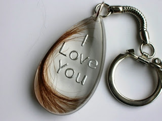Child's 1st haircut preserved within a keyring