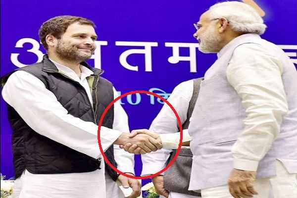 pm-narendra-modi-hand-shake-with-rahul-gandhi-rs-5000-crore-scam