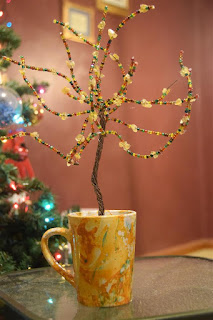 tree craft with beads in a cup
