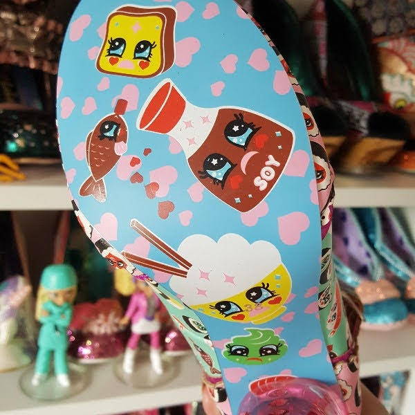 close up of blue shoe sole with cute sushi print