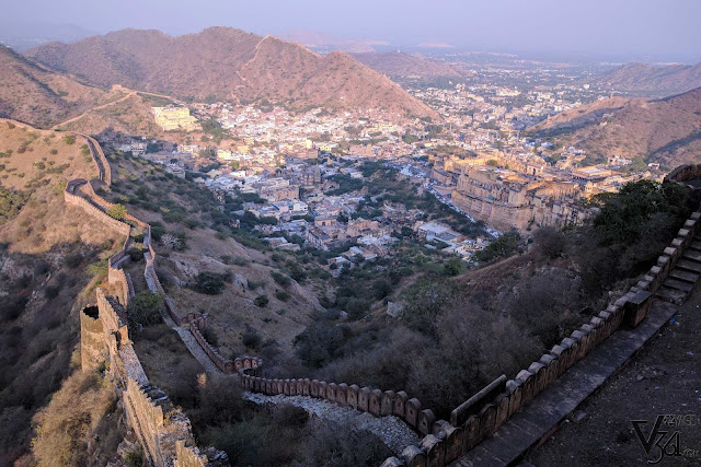 Breathtaking views of the Amber fort and town and the fort passing through the Aravalli mountains as seen from Jaigarh fort