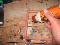 Apply glue along the inside corner of the lid side assembly
