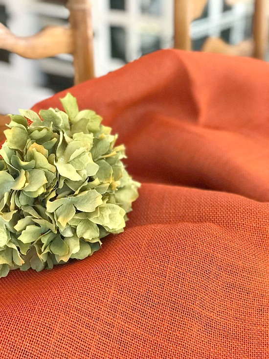 Orange burlap and a hydrangea