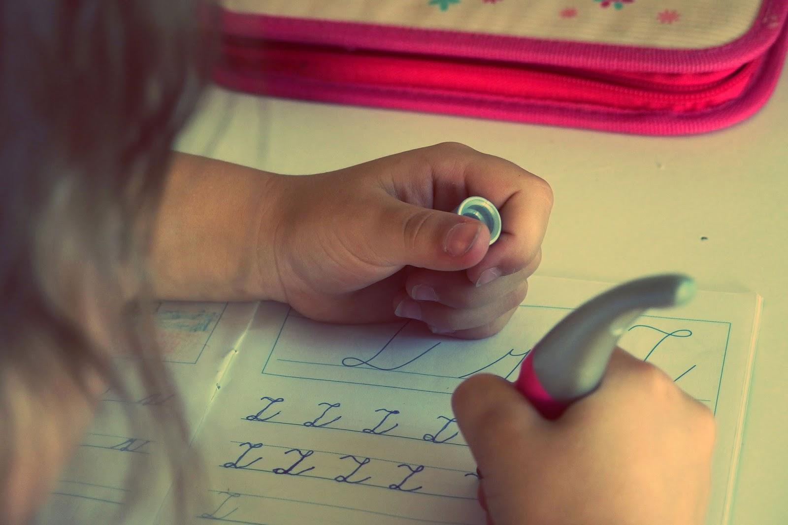 Little girl practising her handwriting - home schooling - motherdistracted.co.uk