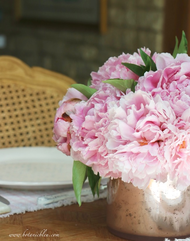 French country early summer table setting with a romantic pink peony centerpiece