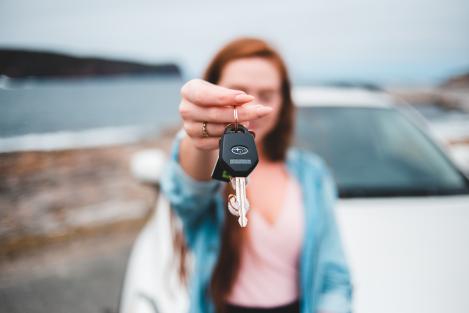 Woman offering a set of car keys