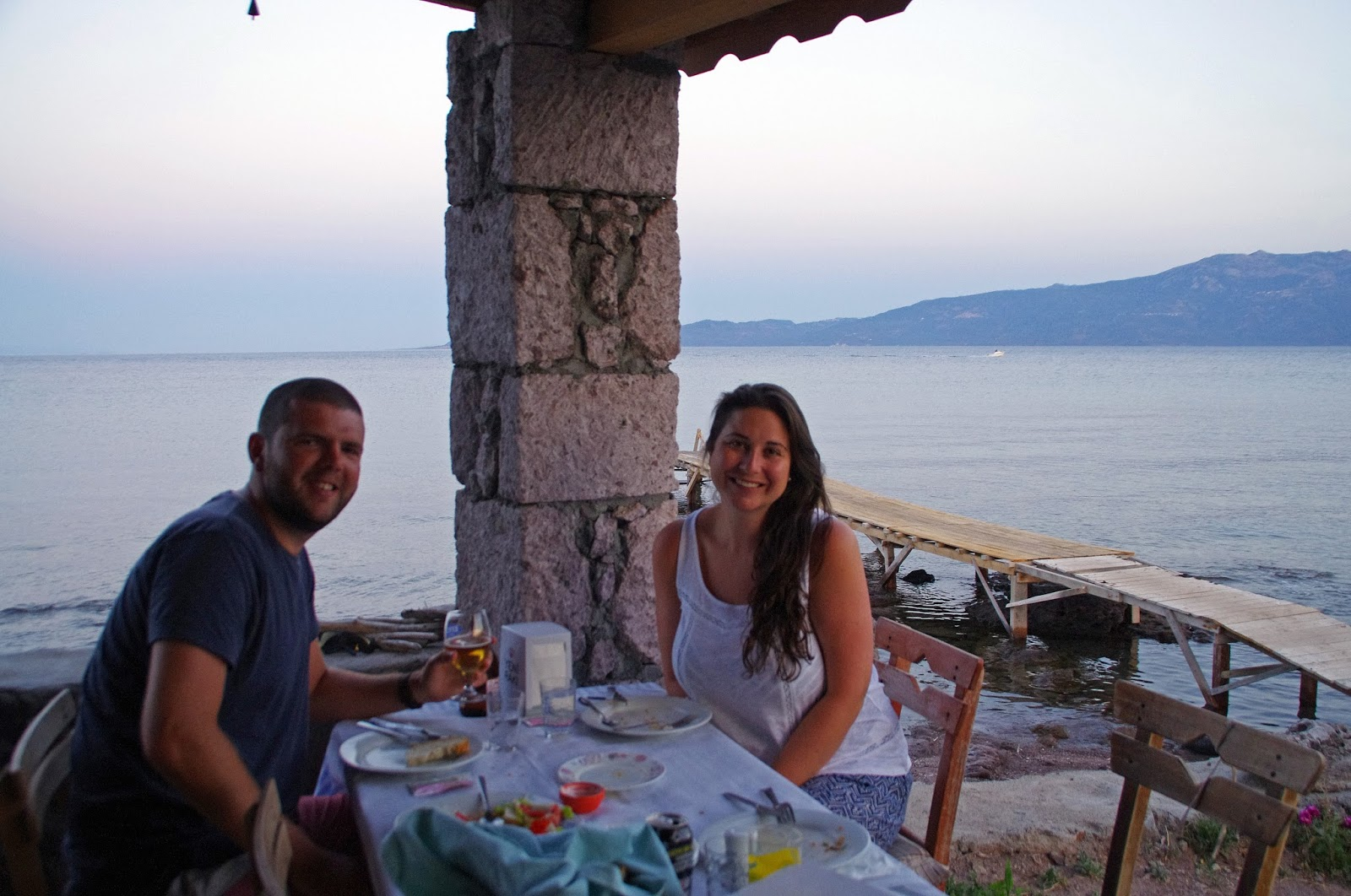 Couple at dinner by the sea in Assos Turkey