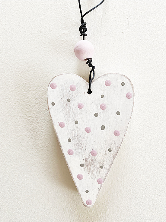 wire hanger with a wooden bead on the heart