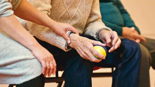 Old person holding a stress ball