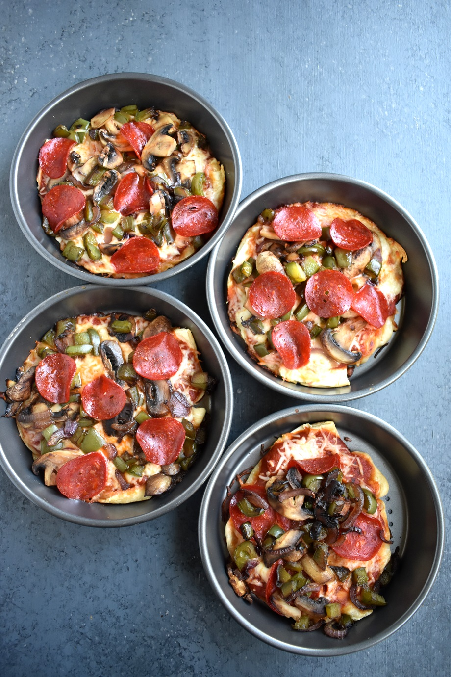 4 mini deep dish pizzas