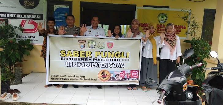 Stop Pungutan liar,  Bhabinkamtibmas Garassi Polres Gowa bersama Kelurahan Garassi Bentangkan Spanduk