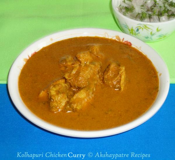 kolhapuri chicken curry in a serving bowl