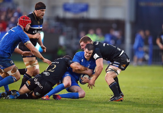 Jamie Roberts and Sam Underhill of Bath Rugby tackling Johnny Sexton (c) of Leinster Rugby