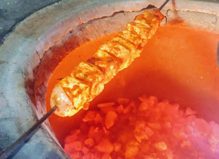 Cooking paneer tikka on charcoal Tandoor for paneer Tikka