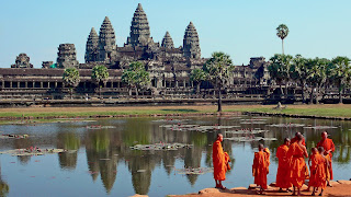 Image of Buddhist Monks at the Reflecting Pool of Angkor Wat temple