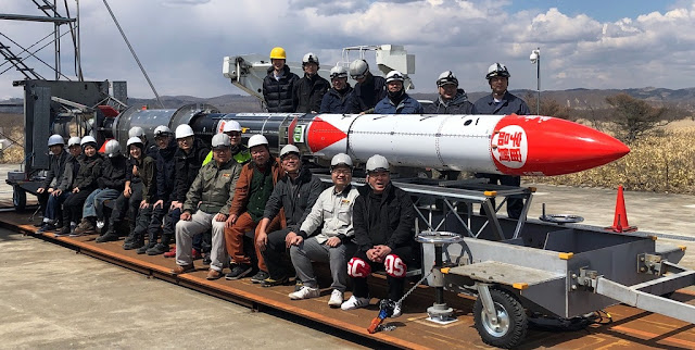 IST crew with the MOMO-F3 rocket. Credit: IST