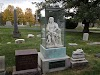 The Story Behind The Statue In Glass Box At Cemetery