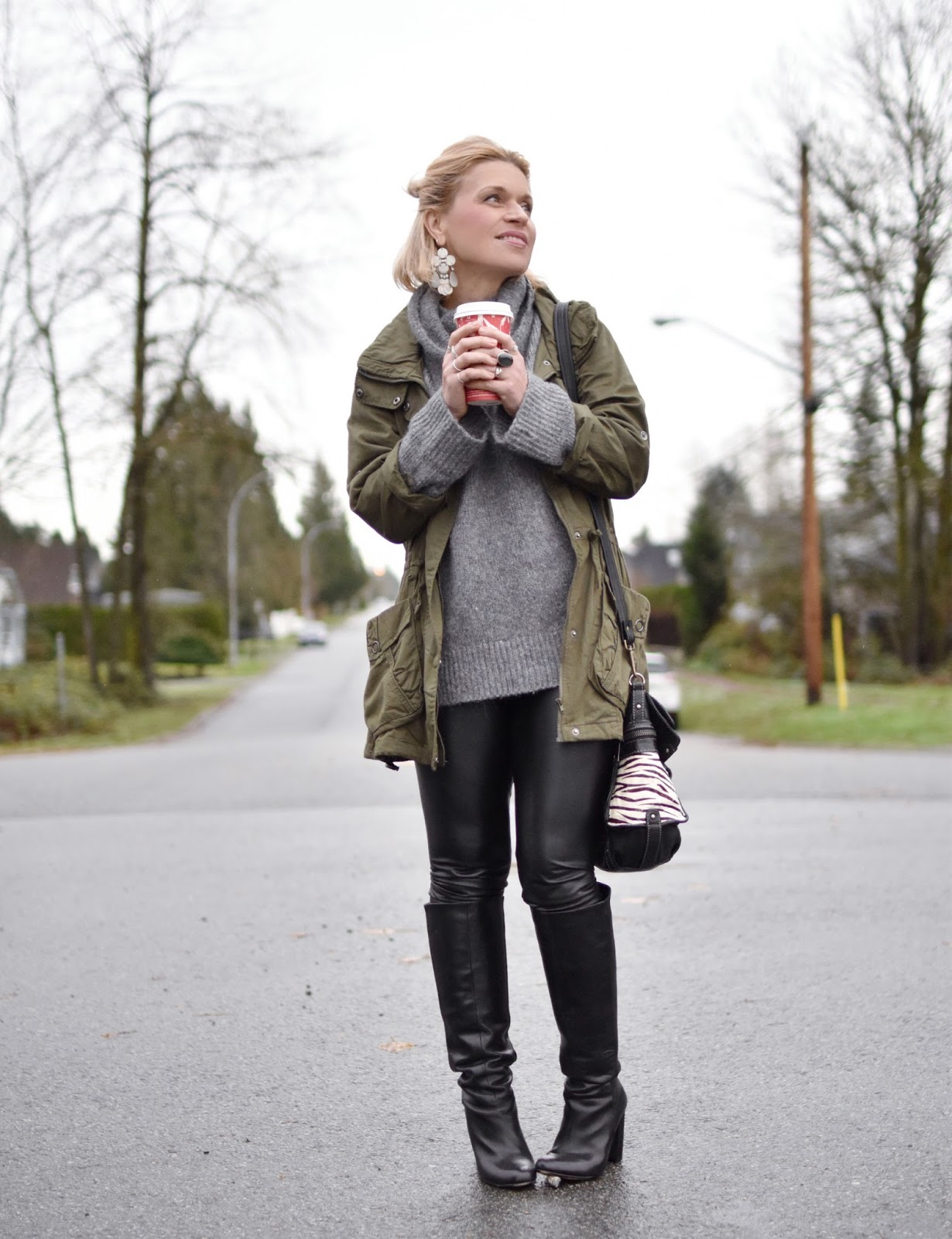 Monika Faulkner outfit inspiration - styling a chunky wool sweater with an army-style jacket, faux-leather leggings, and knee boots