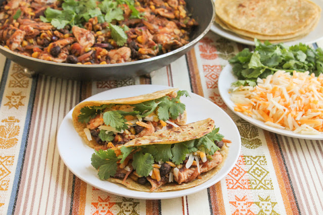 Food Lust People Love: The filling for these Southwestern Chicken Tacos includes corn, black beans, tomatoes, jalapeños, onions and cilantro so, to serve, all you need to add is cheese and the tortillas! (And extra cilantro, if desired.)
