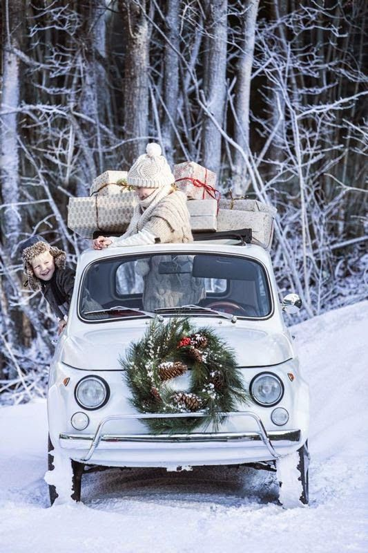 kids with vintage car christmas wreath snow woods presents on top