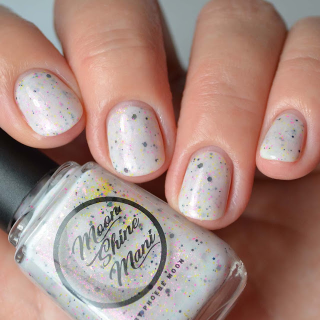 white nail polish with shimmer and colorful glitter four finger swatch
