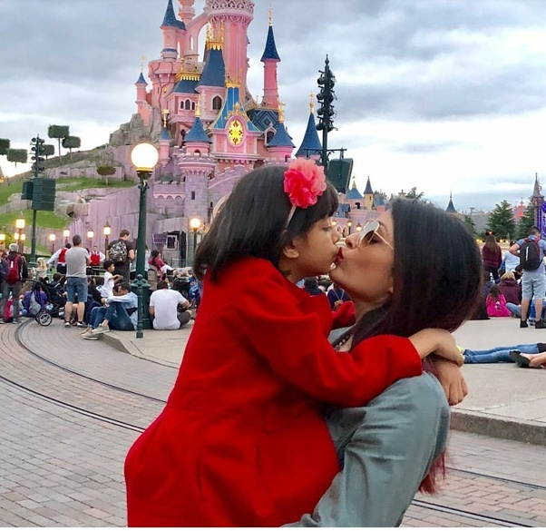Woman Kisses Her Daughter On The Lips