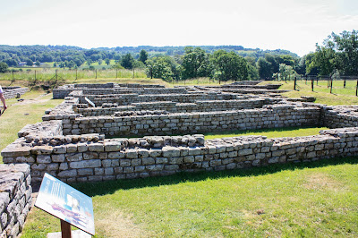 Photo of the Roman ruins, with walls that are now just over a foot high.
