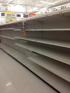 Photo: Empty shelves....water completely sold out due to storm prep