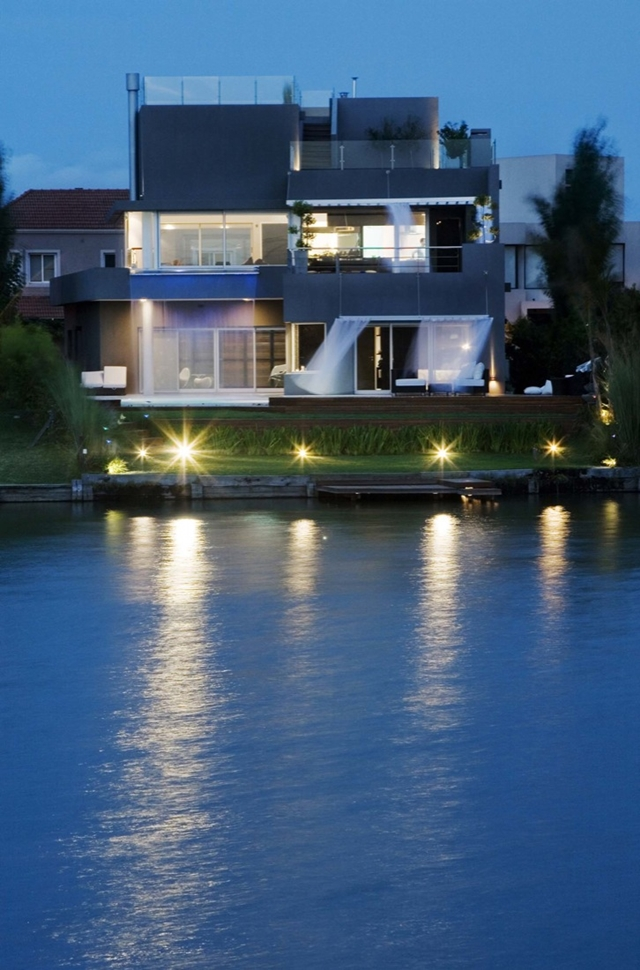 MOdern home at dusk from the lake