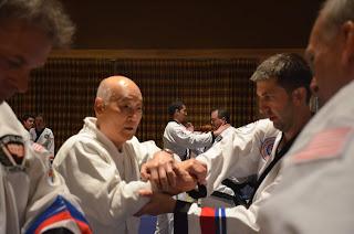 Grandmaster Bong Yul Shin teaching self defense to Moo Sul Kwan black belts