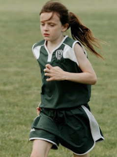 Childhood picture of Rose Lavelle training
