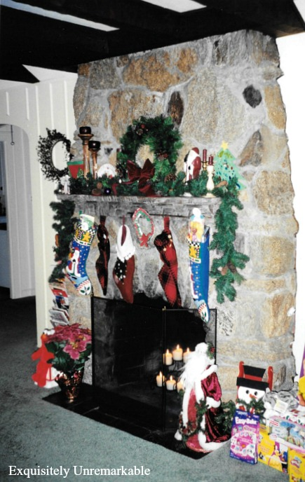 Stone fireplace at Christmas with toys and wreaths