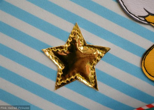 irregular choice whoa bag metallic gold star applique to front