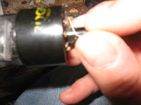 Bend the leads so that they hug the center pin of the vacuum tube
