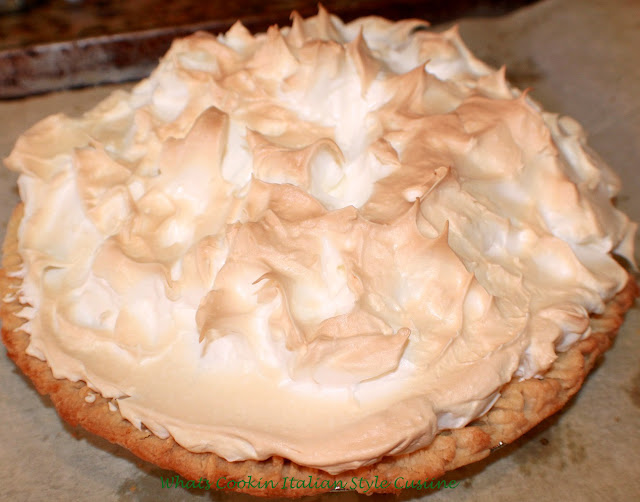 this is a lemon meringue pie cooling on a cookie sheet